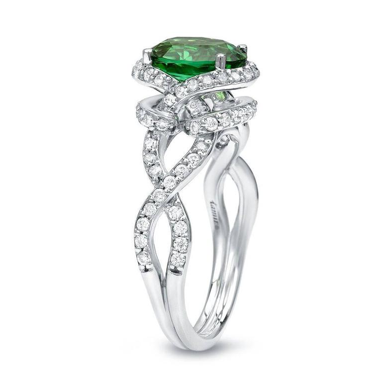 A vivid 1.97ct oval green Chrome Tourmaline, 18K white gold ring, set with a total of 0.58ct round brilliant diamonds. Size 6. Re-sizing is complimentary upon request.  ***Returns are accepted within 7 days of delivery and will gladly be paid by us.