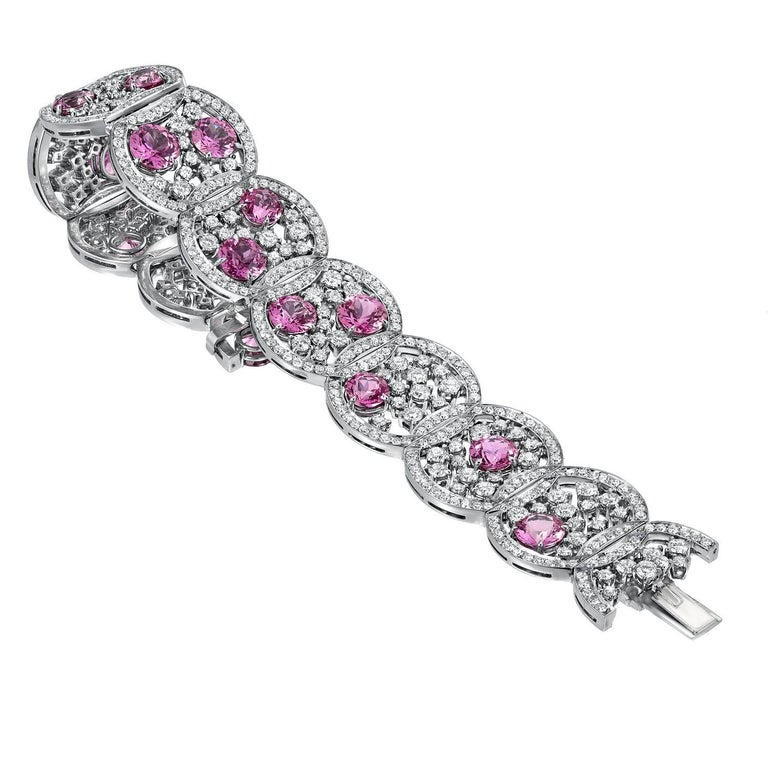 Extraordinary one of a kind hand crafted platinum bracelet, set with 15 round, ultra fine Pink Sapphires weighing a total of 19.54ct, and round brilliant diamonds weighing a total of 10.99ct. Total length: 7 inches. Total width: 1.75 inches.