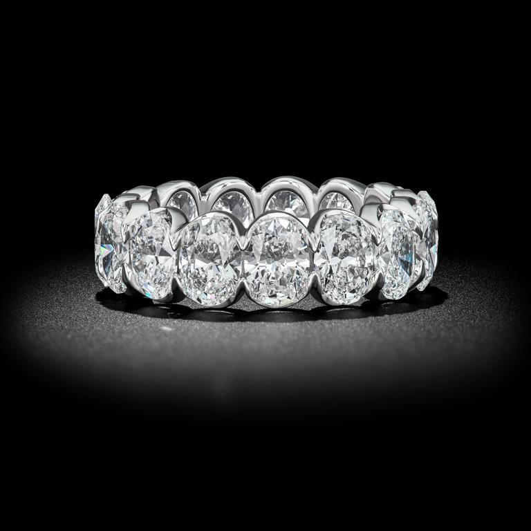 7.40 Carat of Perfectly Matched Oval Shape Half-Bezel Eternity Band These gorgeous Oval shape Diamonds glitter with a fiery brilliance in a unique 18k white gold half-bezel Eternity band. The half-bezel design allows more light to enter each