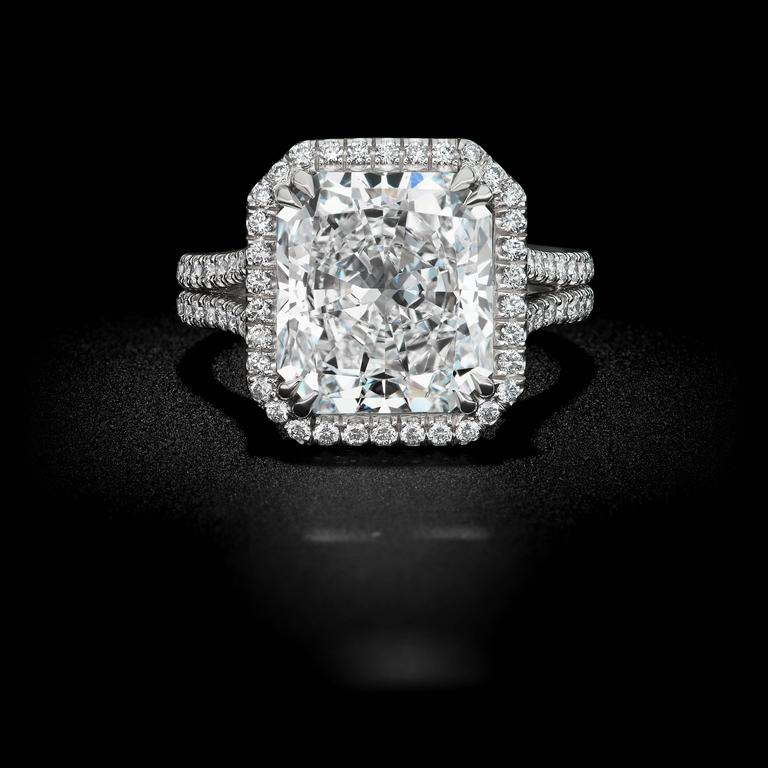 This spectacular 5.52ct Radiant cut diamond ring is set in a beautiful David Rosenberg platinum setting with a color and clarity of E VS1. Along with an elegant micro-pave halo setting with round brilliant diamonds of 1.32tw. This ring is