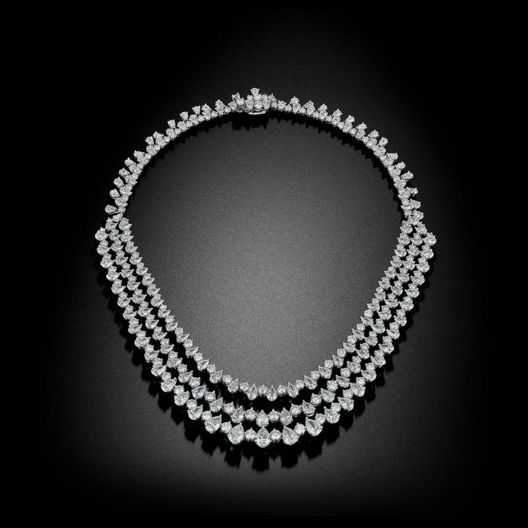 A stunning masterpiece to complete any collection. This captivating necklace features over 80 Carats of some of David Rosenberg's most exceptional Diamonds. Crowned in Platinum, bands of alternating Teardrop Pear Shape and Round Brilliant Diamonds