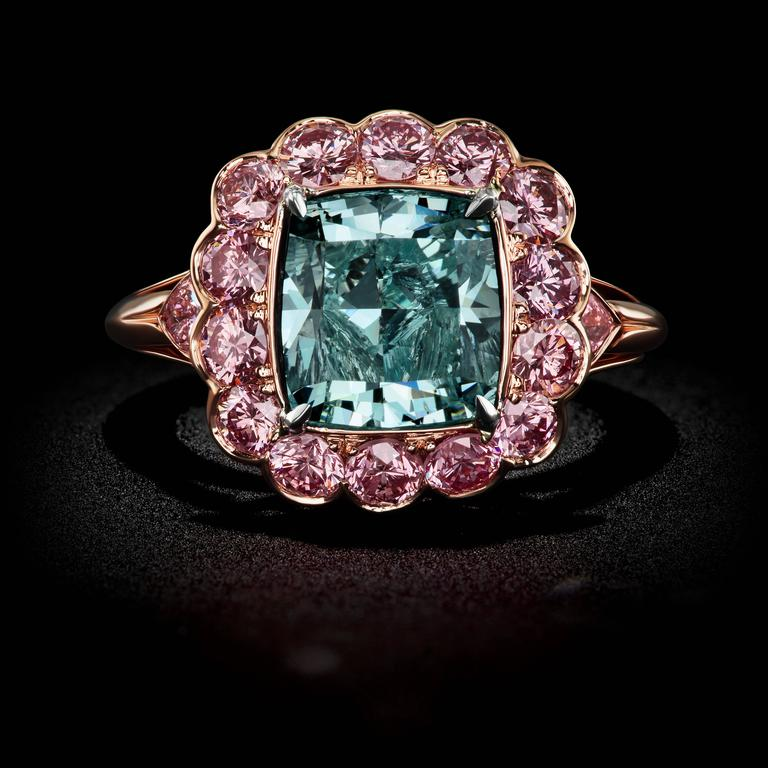A Mesmerizing Fancy Intense Blueish Green Cushion Cut Diamond GIA Cert Ring by David Rosenberg.  This handmade 18kt Rose Gold Ring with a 4.16ct Cushion Cut Fancy Intense Blueish Green Diamond is accompanied with a GIA Certificate and a Stephen