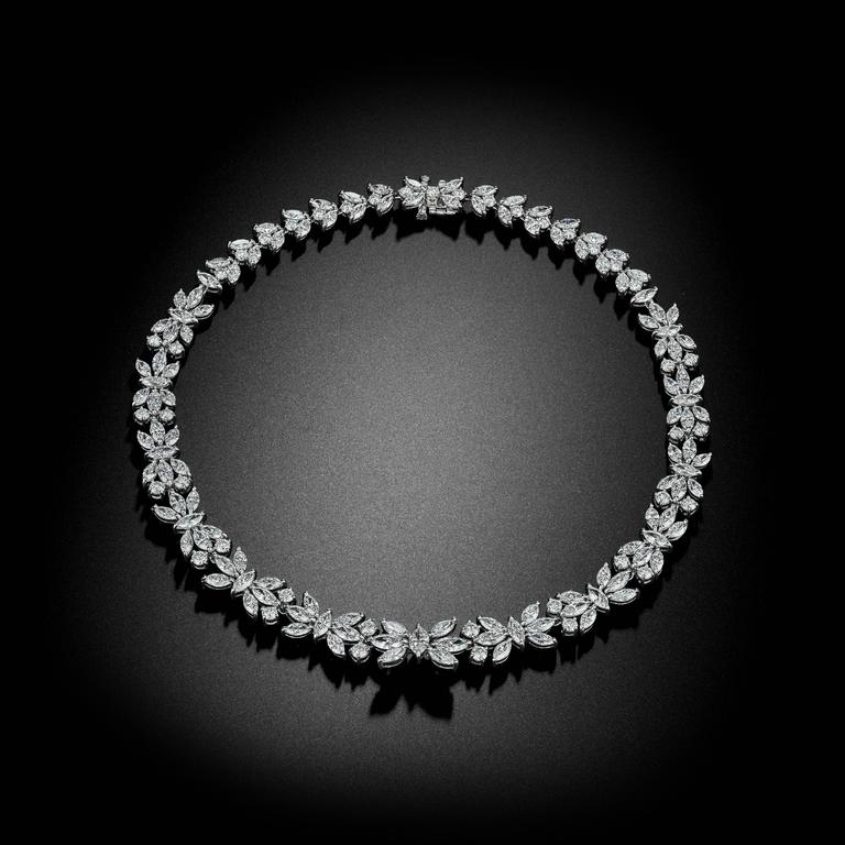 This handmade Platinum Necklace is set with Brilliant and Marquise Shape Diamonds and has an approximate total weight of 49.75ct tw. A unique and timeless piece!
