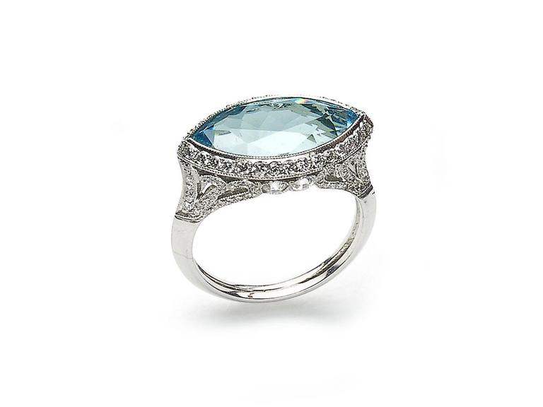 An aquamarine and diamond ring mounted in platinum, set with a marquise-cut aquamarine weighing an estimated 4.69ct, with a decorative diamond set mount, estimated total diamond weight 1.10cts, ring size N