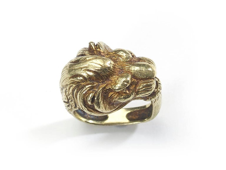Antique French gold lion ring , the heavy weight ring designed as a sculpted lion head, square shaped on an 18ct gold band, bearing French marks and an illegible makers mark UK J US 4 5/8