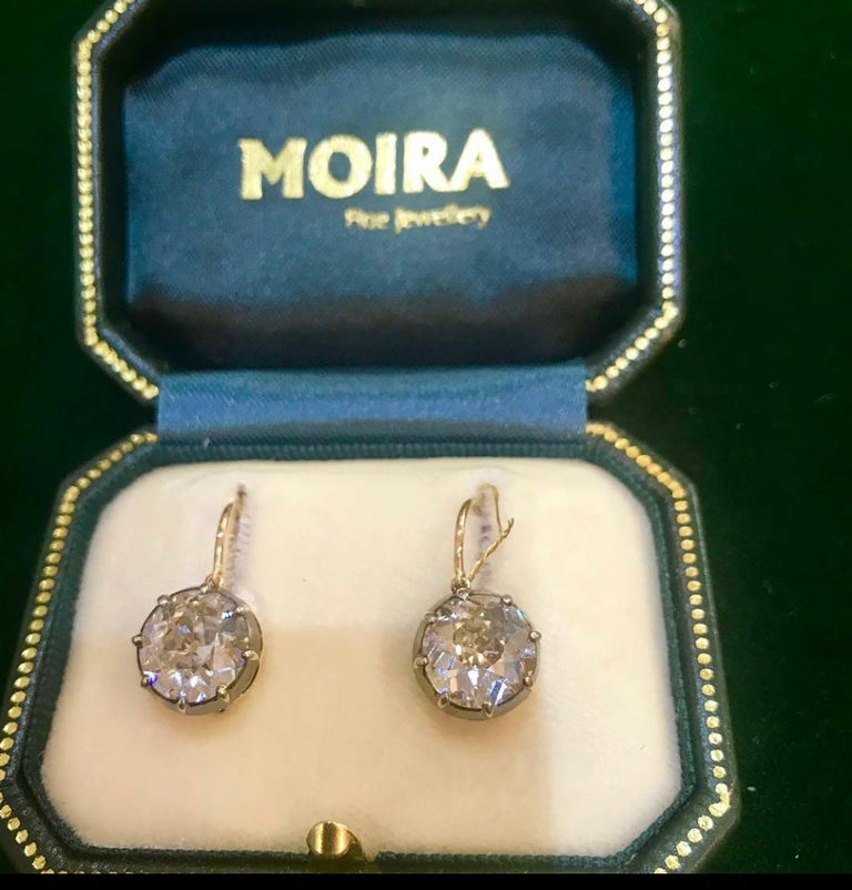 A pair of antique diamond drop earrings, set with old-cut diamonds, with a total weight of 6.64ct, in silver-upon-gold, cut down settings, with gold gallery work, on hooks, accompanied by GIA certificates. Mounts circa 1890, with new hooks. 3.51ct J