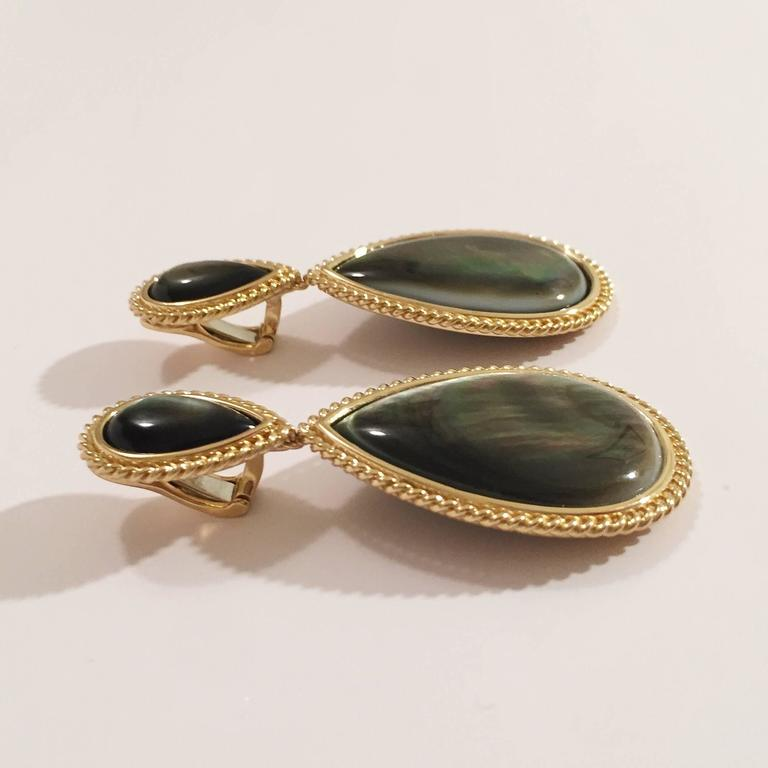 """18kt Yellow Gold Pear Shaped Drop Earring with Abalone Mother of Pearl finished with elegant Rope twist border.  The earrings measure just over 2 1/2"""" long and approximately  1 1/4"""" at its widest point and just under 3/4"""" across the"""