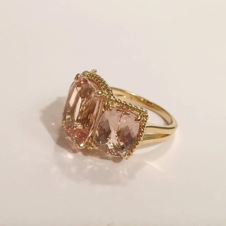 """Elegant 18kt Yellow Three Stone Ring with Rope Twist Border with split shank detail. The ring features three faceted cushion Cut Morganite all surrounded by twisted gold rope.    The center morganite measures 5/8"""" tall (including the rope"""