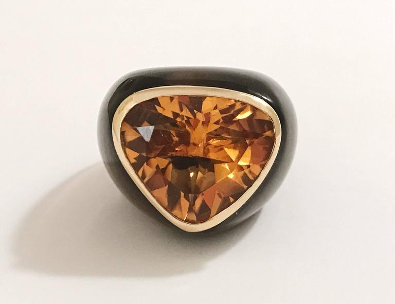Suzanne Belperron Earring and Ring Set   Modern Design with fantastic scale.  This carved Smoky Topaz Suite is set with faceted deep colored Citrines that are bezel set in 18kt Yellow Gold.  The ring is size 6 3/4 but can accomodate other ring