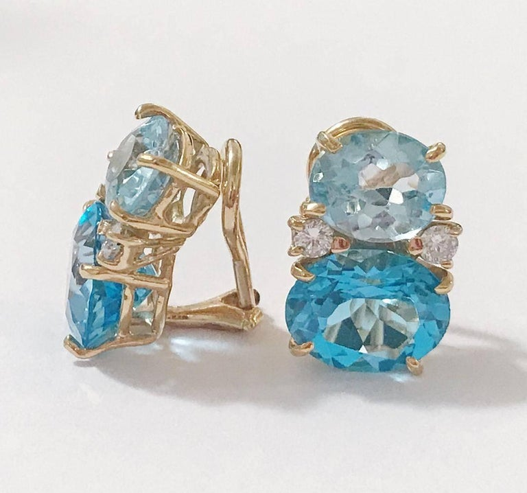 Medium 18kt yellow gold GUM DROP™ earrings with Two Toned faceted Blue Topaz (approximately 2.5 cts each), faceted Blue Topaz  (approximately 5 cts each), and 4 diamonds weighing ~0.40 cts.   Specifications: Height: 3/4