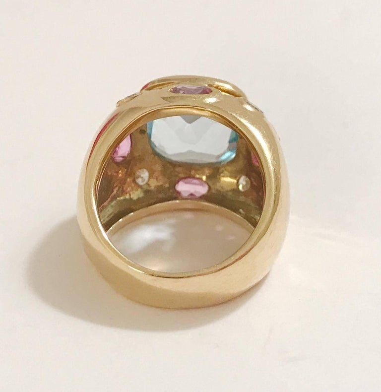 The BONHEUR Ring: 18kt Yellow Gold Domed Ring with faceted blue topaz cut center stone and faceted oval Pink Topaz and round Diamonds.   This ring is available in in any color stone combination.  This ring may be sized.  Please contact me with any