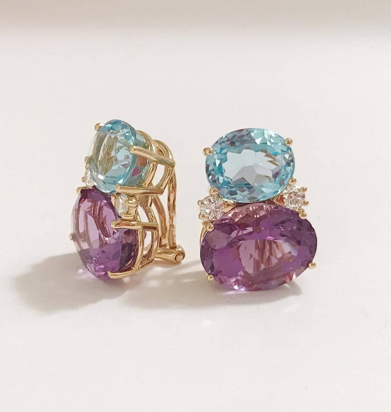 """Large 18kt yellow gold GUM DROP™ earrings with Pale Blue Topaz (approximately 5 cts each), bright purple amethyst (approximately 12 cts each), and 4 diamonds weighing 0.60 cts.  The earrings measure 1"""" tall and 3/4"""" wide at its widest part"""