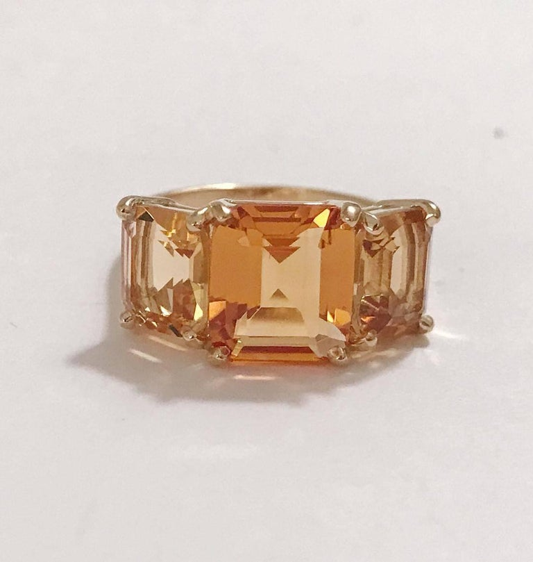 18kt Yellow Gold Mini Emerald Cut Ring with Two Toned Citrine  This mini emerald cut ring can be made in any ring size and with any colored semi precious stone combination. example: Blue Topaz Center and Peridot stones or Pink Topaz Center and
