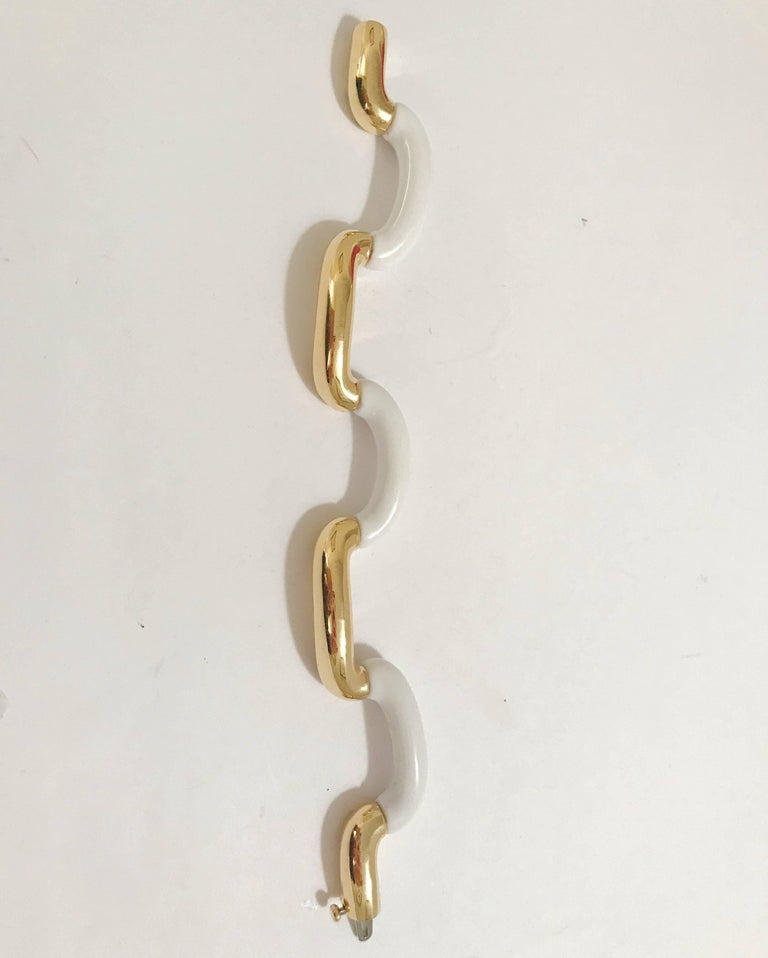 18kt Yellow Gold and White Jade Tubular Bracelet, is great statement piece.  This bracelet can be made to any size wrist and any color gold as well as any kind of stone to substitute the white jade (example: onyx or Amethyst).  Please let me know if