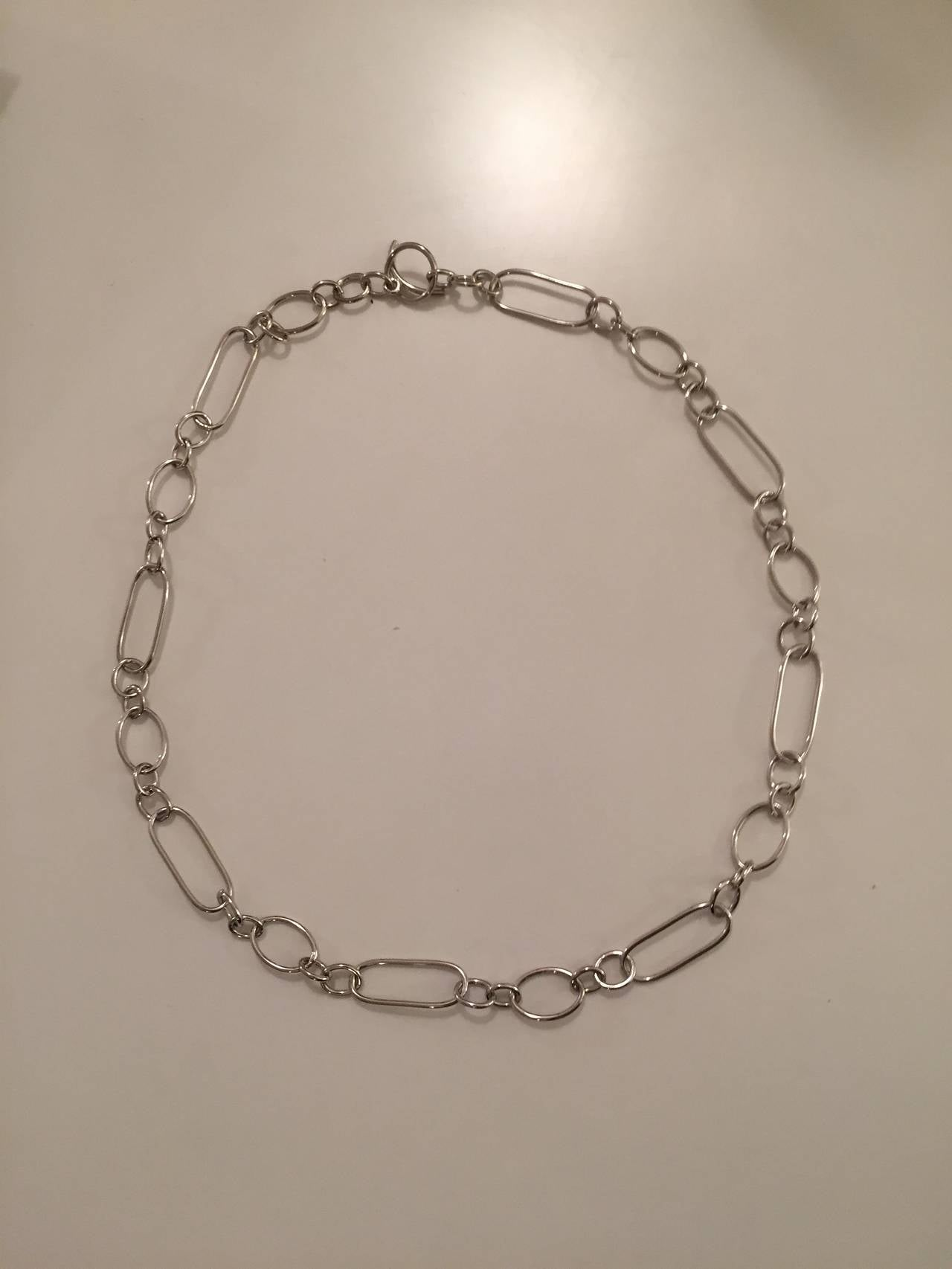Mixed Shape 18kt White Gold Link Necklace with Toggle Closure In New Condition For Sale In New York, NY