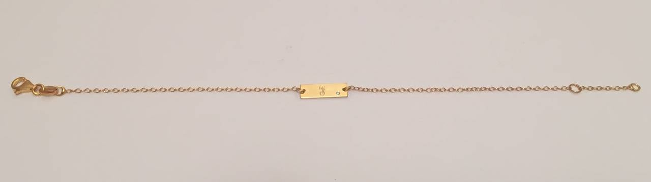 Initial plate bracelet with diamond accent.  Personalize this delicate bracelet with off set diamond accent.  The gold plate is approximately 1/2