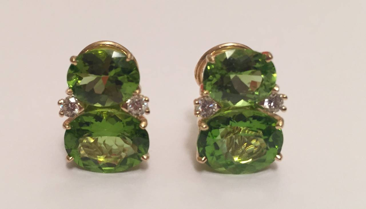 18kt Yellow Gold GUM DROP™ Earrings with Peridot and diamonds.  These elegant GUM DROP™ earrings host two gorgeous shades of Peridot and 4 diamonds weighing approximately 0.40cts.  The earrings can be made for clip or pierced earrings.
