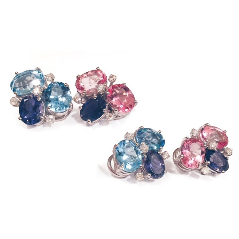 This elegant mini cluster combines Pink Topaz and Iolite with the sparkle of 8 diamonds weighing approximately 0.25 cts  The earrings measure 5/8