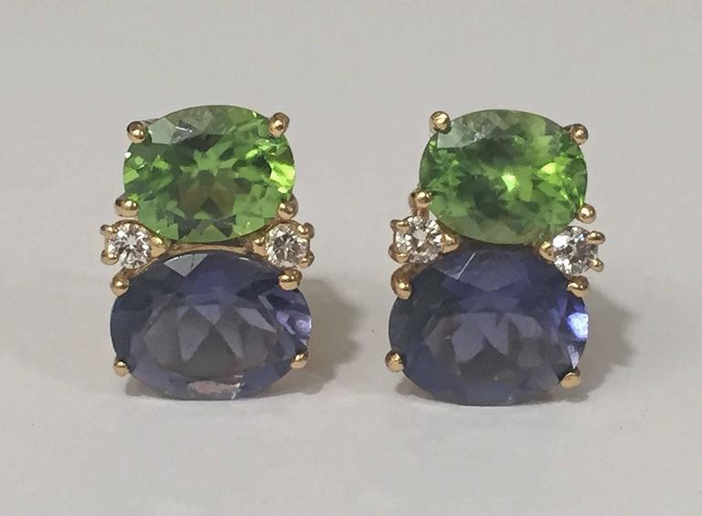 """Medium 18kt yellow gold GUM DROP™ earrings with faceted Peridot (approximately 2.5 cts each), faceted Iolite (approximately 5 cts each), and 4 diamonds weighing ~0.40 cts.   Specifications: Height: 3/4"""", Width: 1/2"""" Omega clip"""