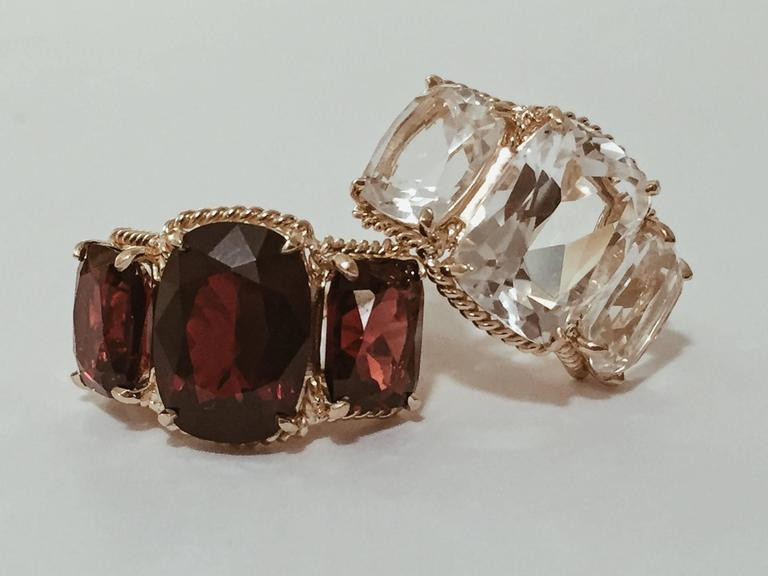 Contemporary Elegant Three Stone Garnet Ring with Gold Rope Twist Border For Sale