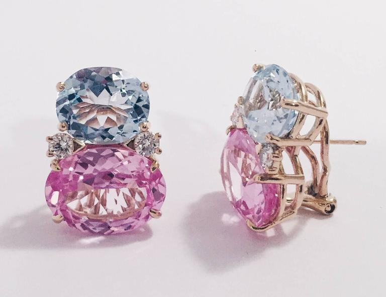 18kt Yellow Gold Large GUM DROP™ Earrings with faceted Blue Topaz and Pink Topaz and diamonds. The Top oval Blue Topaz is approximately 5 cts each and the Bottom faceted Pink Topaz is approximately 12 cts each, and 4 diamonds weighing