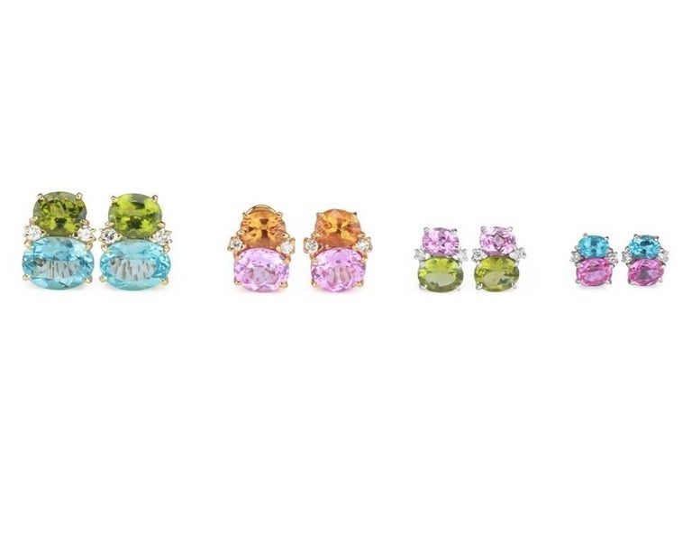 """Medium 18kt White gold GUM DROP™ earrings with pink topaz (approximately 2.5 cts each), peridot (approximately 5 cts each), and 4 diamonds weighing 0.40 cts.  Specifications: Height: 3/4"""", Width: 1/2"""" Omega clip back. Can be posted for"""