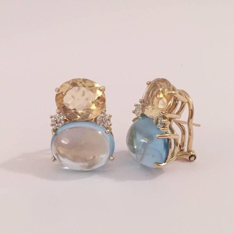 18kt Yellow Gold Large GUM DROP™ Earrings with faceted Citrine and Cabochon Blue Topaz and diamonds. The Top oval faceted Citrine is approximately 5 cts each and the Bottom cabochon Blue Topaz is approximately 12 cts each, and 4 diamonds weighing