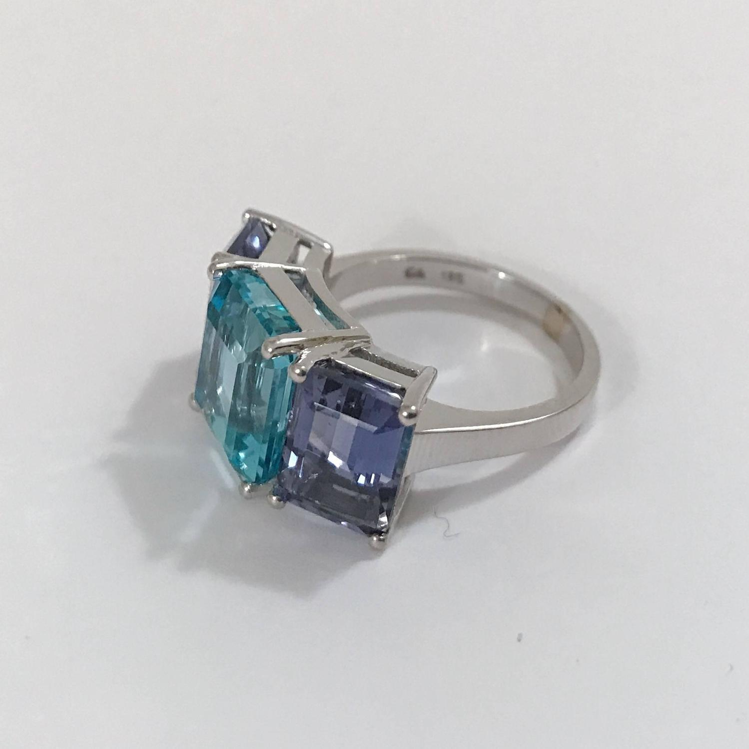 18kt white gold three emerald cut ring with blue