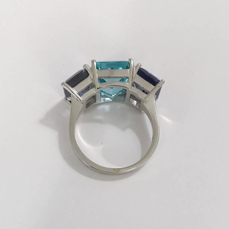 18kt White Gold Three Stone Emerald Cut Ring with Blue Topaz and Iolite In As New Condition For Sale In New York, NY