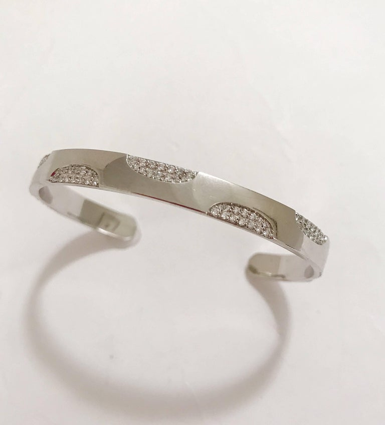 18kt White Gold Polka Dot Diamond Cuff Bracelet, is a great addition for stacking bracelets or is beautiful alone.   This Bracelet can be made in any color gold and fits to all wrist sizes.   Please contact us with any inquiries you may have.