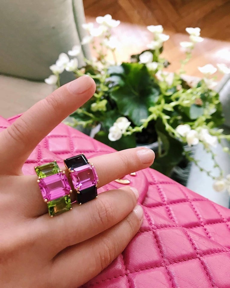 Contemporary Bright Blue and Bright Pink Topaz Emerald cut three stone ring For Sale