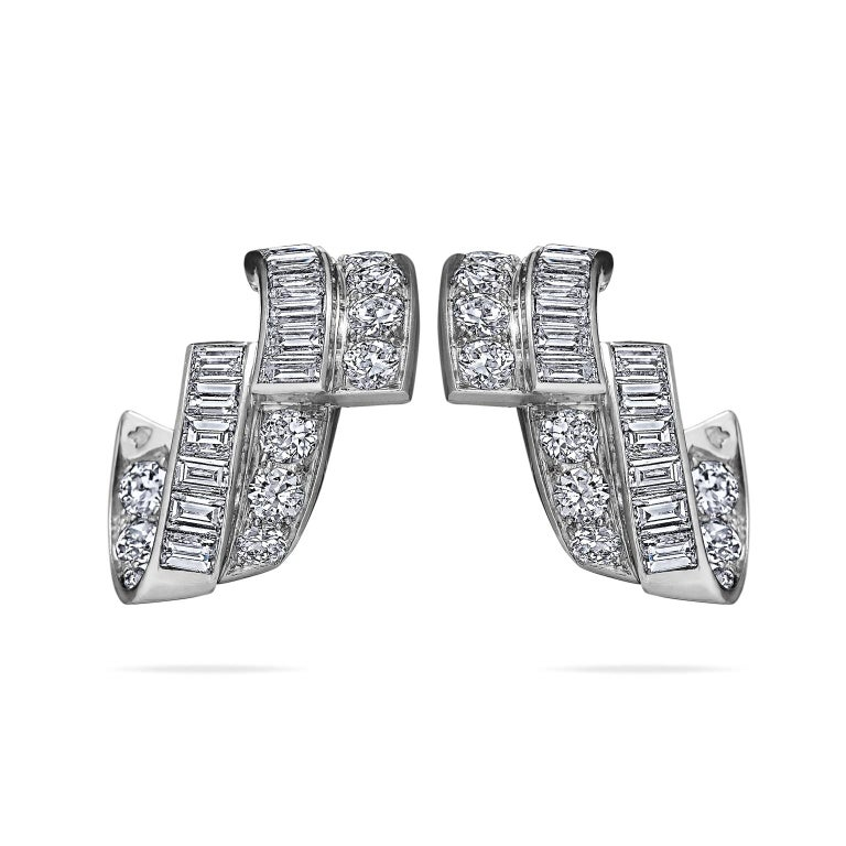Ribbons of diamonds are endless in these one-of-a-kind French Art Deco earrings.  With 1.85 carats of cascading fiery baguette and old european cut diamonds mounted in platinum, these clip earrings evoke a bespoke era.  3/4