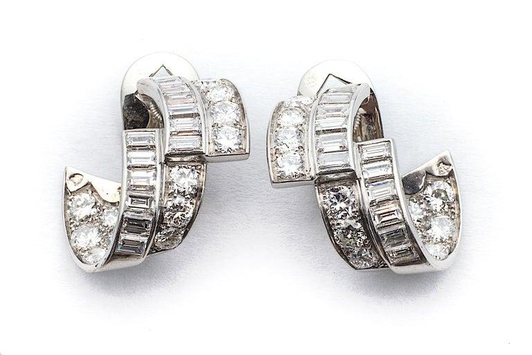 Emerald Cut Art Deco Diamond Platinum Ribbon Earrings For Sale