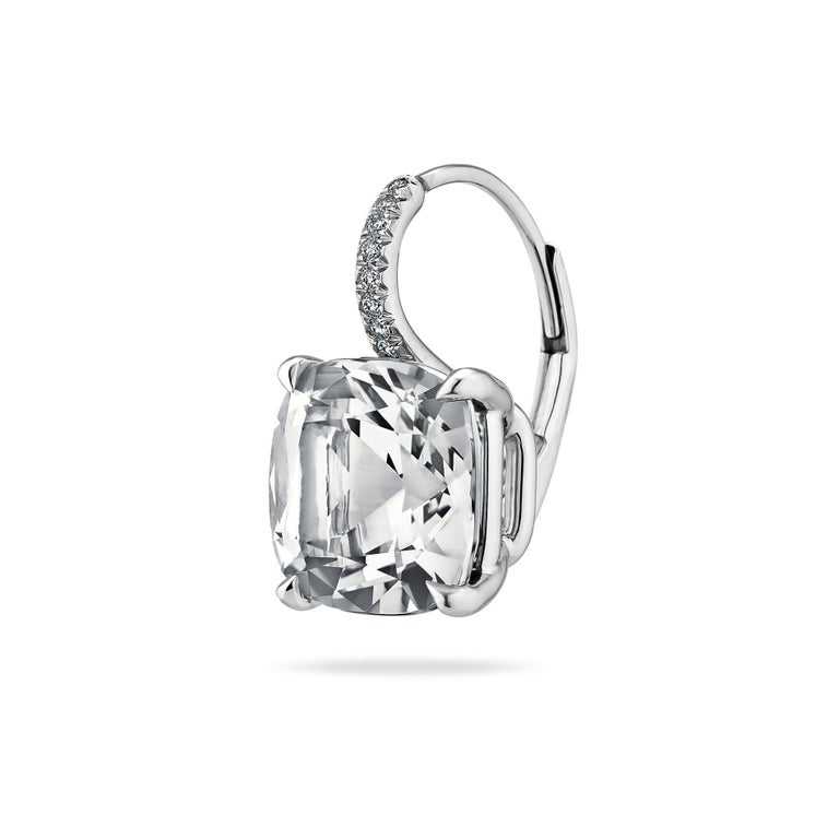 Cool as ice, these medium size white topaz cushion cut gems, weighing a total of 9.46 carats, hang seductively from platinum diamond set wires. Total diamond weight .09 carats. Lever backs.  5/8