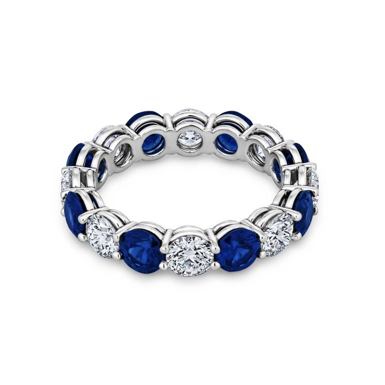 Handmade round ideal cut diamond and sapphire platinum shared prong band ring.  Designed by Steven Fox.  Total diamond weight 2.01 carats.  D-E color/VVS clarity.  Total Sapphire weight 2.72 carats.  Size 6.  Can be custom ordered to size.
