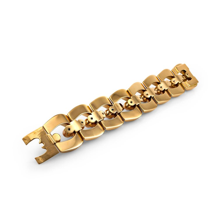 Designed in the 1940's by Bulgari and influenced by World War II, this one-of-a-kind handmade bracelet draws it's inspiration from wartime tank tracks and treads as well as the emergence of machine assembly line parts. Created in 18 karat yellow and