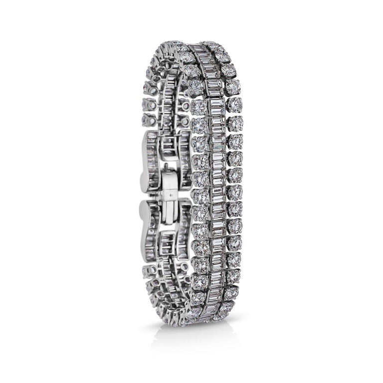 Sensuously supple and sparkling like ice, this mid-century Boucheron Paris bracelet is enchantingly irresistible.  With approximately 38 carats of round and baguette cut diamonds, this extraordinary jewel only appears once in a lifetime.  Circa
