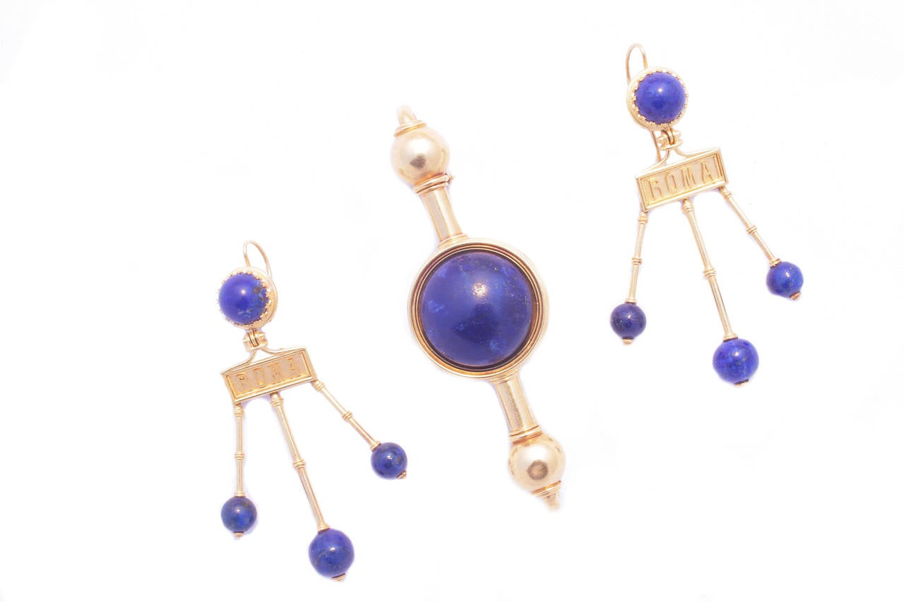 Comprising necklace, earrings and brooch, manufactured by the historic Roman jeweller Travaglini, embellished by spherical lapis-lazuli elements on a polished  yellow gold mounting typical of the time, marked