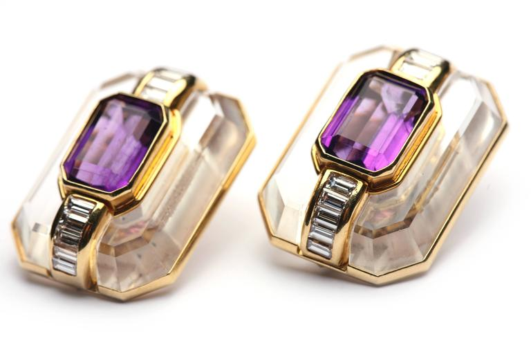 A chic pair of octagonal design ear-clips made in rock crystal, centering two octagonal cut amethysts, highlighted with baguette cut diamonds. Mounted on 18kt yellow gold. Circa 1978