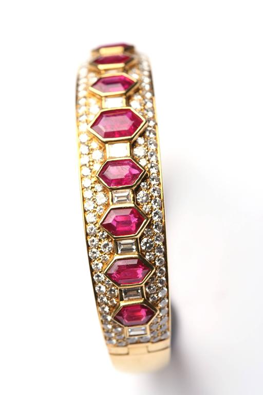 An iconic ruby and and diamond bangle of geometrical design, by Bulgari, circa 1965.