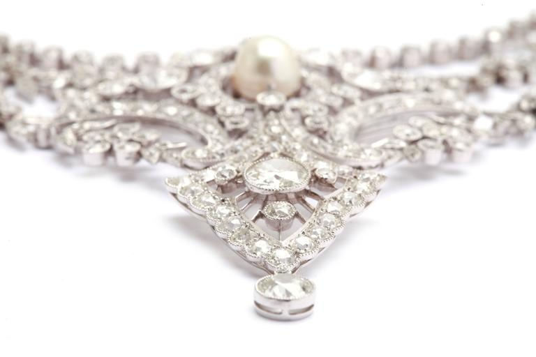 An extraordinary Belle Èpoque diamond and Natural Pearls collier by French Masters Caillot & Peck, circa 1890. Platinum mounting.