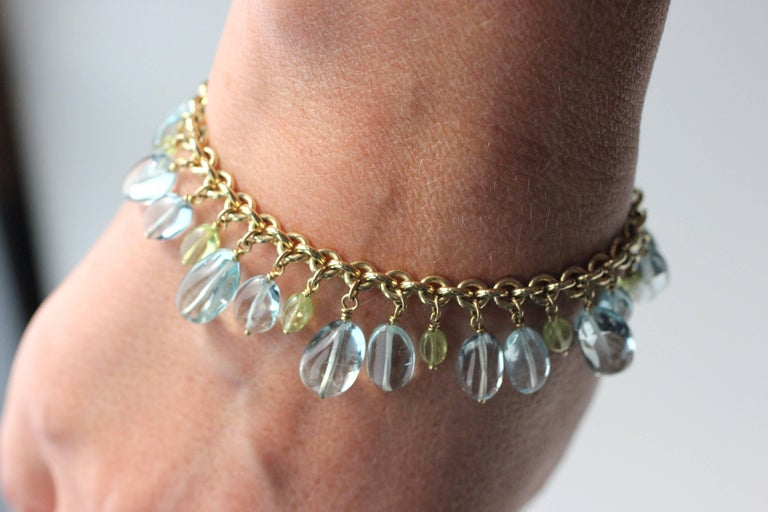 This beautiful beaded chain bracelet features an 18 Kt Gold link chain, 20 oval Aquamarine beads (45.00 cts) and 10 oval Chrysoberyl beads (7.2 cts).  Designed and made in-house by Julius Cohen New York.