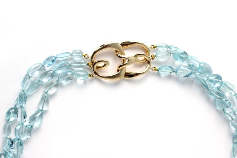 This three strand Aquamarine Necklace contains 306.42 Carats of beautiful, clear Aqua beads and has a signature Julius Cohen 18 Kt Gold Hook clasp.  Designed and made in house by Julius Cohen New York.