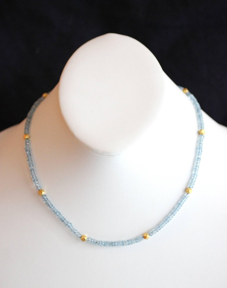 This beautiful and understated necklace contains approximately 37 carats of faceted Aquamarine beads punctuated by 24 Kt Gold Polyhedron Bead rondelles.  Closure is a classic Julius Cohen S-clasp, in 18 Kt Gold for added strength and durability.