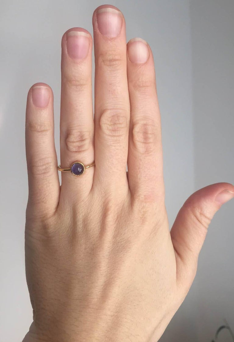 Sweet and minimal 18Kt Gold and Cabochon cut Iolite Ring.  Designed and made in house by Julius Cohen New York.