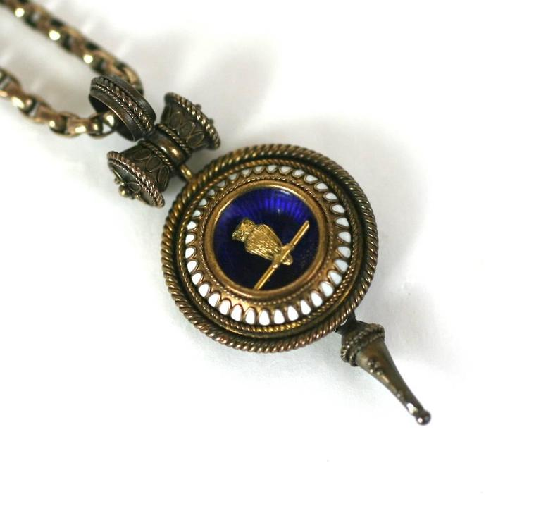 Charming Victorian Revivalist Owl Necklace from the late 19th Century. Charming owl motif which signified knowledge and wisdom, rendered as a beautifully detailed gold bird on branch within a blue enameled cup, bordered with white enamel and