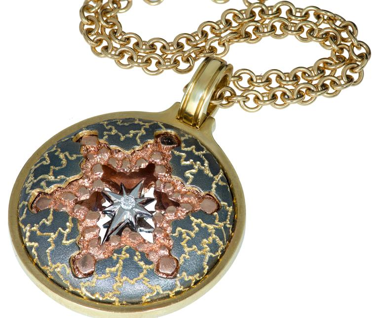 Alex Soldier Diamond Gold Star pendant in 18 karat white, yellow and rose gold features a special mirror effect to enhance multi-dimensional appeal. The composition is further enhanced with final touches of fine texturing, hand-applied in several