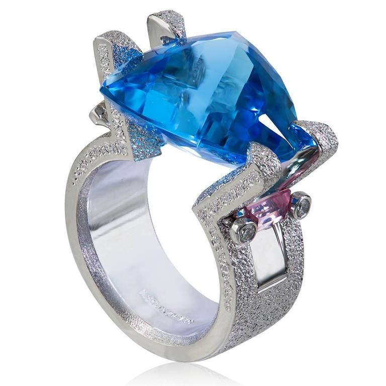 Alex Soldier Equilibrium ring in 18 karat white gold with trillion cut tension set blue topaz (12 ct), pink tourmaline (0.6 ct), and diamonds (0.1 ct). One of a kind. Handmade in NYC. Ring size: 6.25. Complimentary ring sizing is available within 2