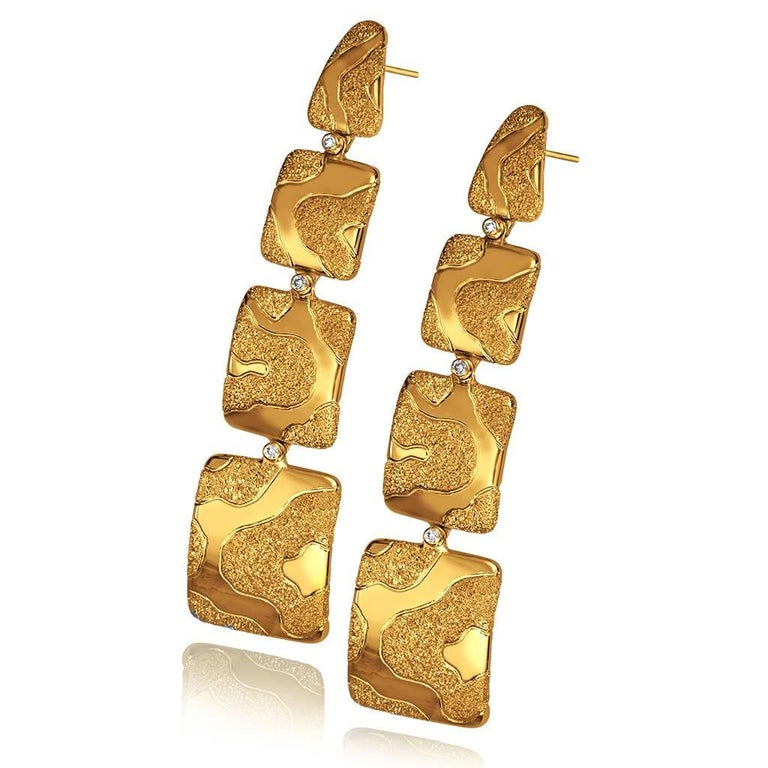 Alex Soldier Gold Cora drop earrings made in 18 karat yellow gold with white diamonds (0.05 ct), finished with signature proprietary metalwork that creates an illusion of inner shimmer. Handmade in NYC. One of a kind. Please note that carat weights