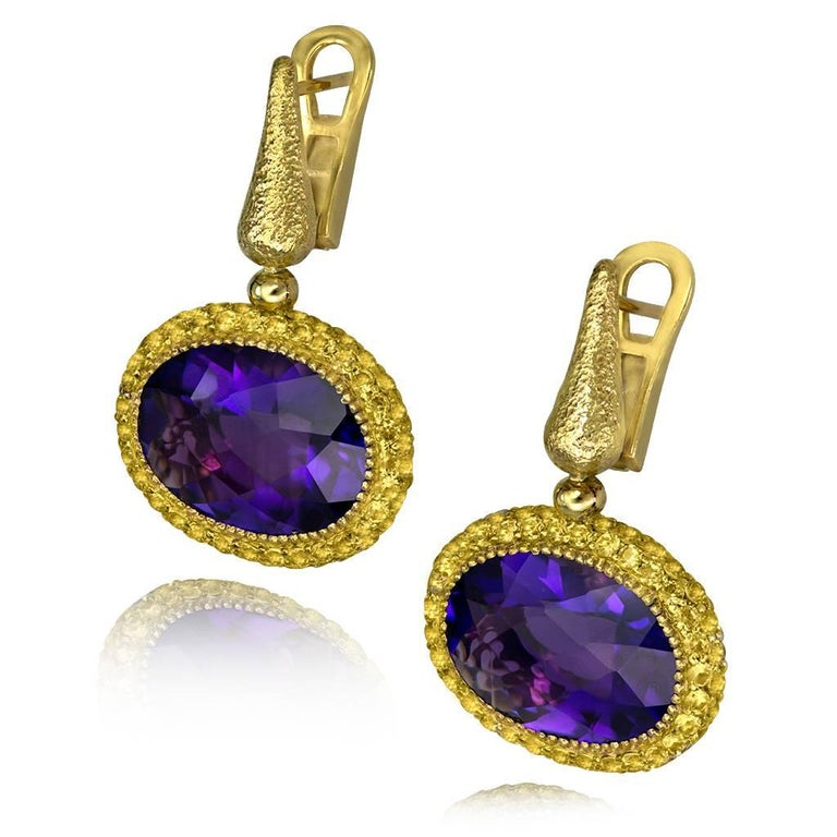 Alex Soldier's Cocktail Drop Earrings are made in 18 karat yellow gold with 18 carats of amethysts and 4.4 carats of yellow sapphires. These stunning earrings feature a signature metalwork, handmade in NYC. One of a kind.
